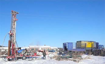 Drilling rig at the construction site on the Sino-Russian border at minus 32 deg